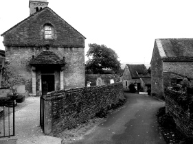 Street and church in the village of Taizé, close to the much larger and more crowded commune
